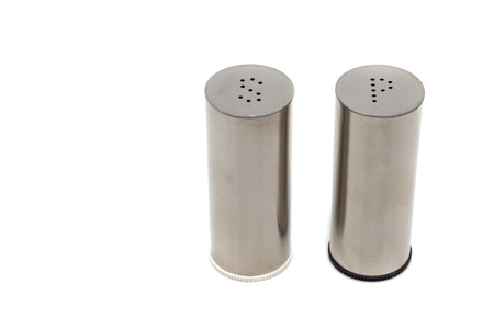 white pepper: Stainless steel salt and pepper shakers isolated on white background Stock Photo
