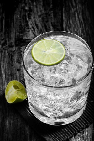 cocktail strainer: Classic margarita cocktail on wooden table with limes,Black and White Stock Photo