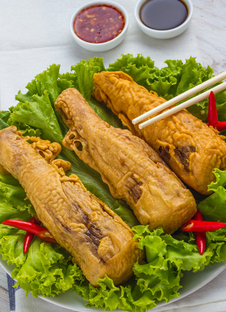 asian fried bamboo shoots on a plate with salad.top view of a vertical .thai style