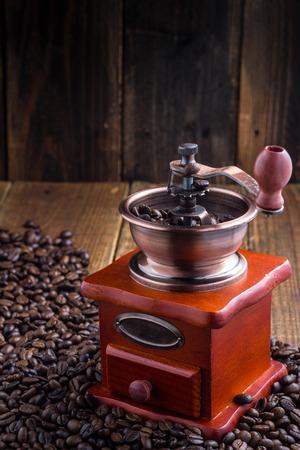 Vintage manual coffee grinder with coffee beans
