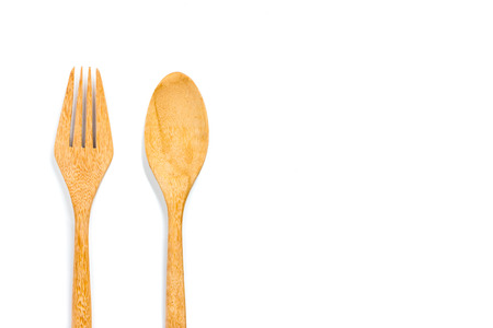 Wooden fork and spoon isolated on white background