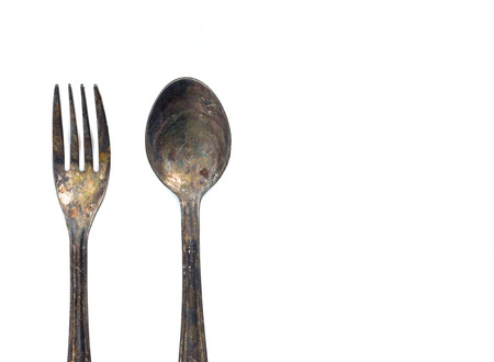 Old fork and spoon isolated on white background Banque d'images