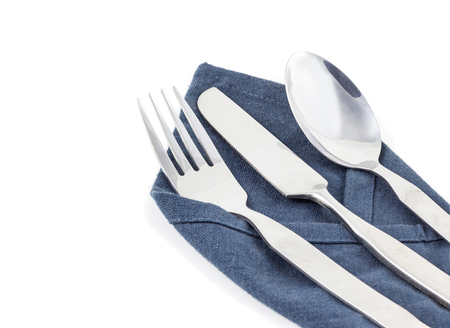 Knife, fork and spoon with linen cloth, isolated on the white background