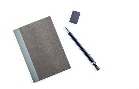 pens: Black paper notepad with pencil. Isolated on white background