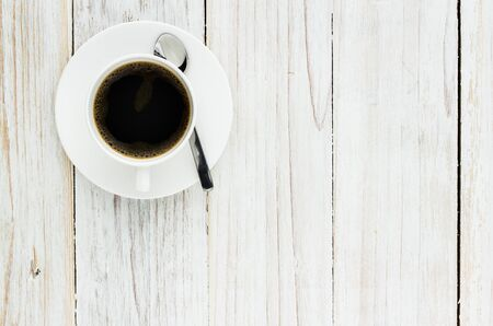 blank space: Coffee Cup on Wooden Table Background, View from above with copy space. Stock Photo