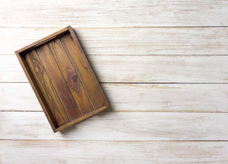 Empty wooden box. On  white painted wooden table. Top view with space for your text