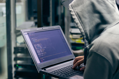 Hacker Breaking into Corporate Data Servers. Place Has Dark Atmosphere Foto de archivo