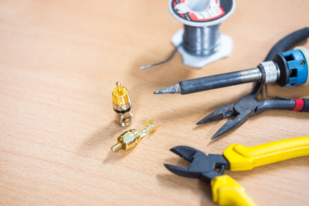 Closeup of soldering RCA cable, Repair and adjustment of the equipment, the RCA cable and pliers on the table