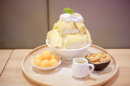 Bingsu Durian with Durian ice cream and Whipped cream served with condensed milk and melon. Фото со стока