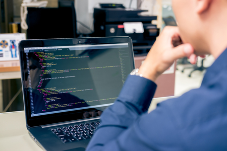 Developing programming and coding technologies on desk white blurry screen, Website design, Programmer working in a software develop company office,Data processing center, Server room Фото со стока