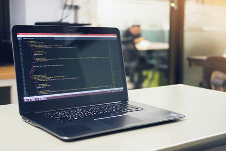 Developing programming and coding technologies on desk white, Website design, Programmer working in a software develop company office,Data processing center, Server room Foto de archivo