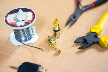 Repair and adjustment of the equipment, the RCA cable and pliers on the table
