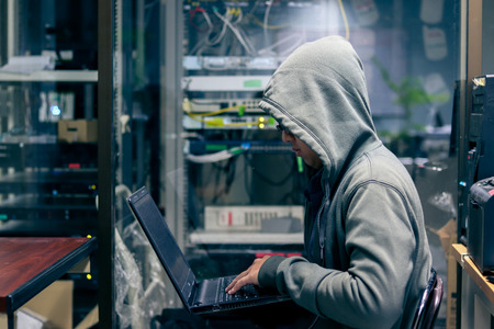 Hacker Organizes Massive Data Breach Attack on Corporate Servers. He is in  Secret Location. Their Hideout is Dark, Neon Lit