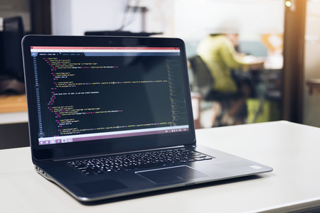Developing programming and coding technologies on desk white, Website design, Programmer working in a software develop company office,Data processing center, Server room Фото со стока