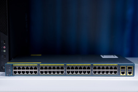 48 port fast network switch front view on the dark background, Used in data center. networking concept and Information technology. Stock Photo