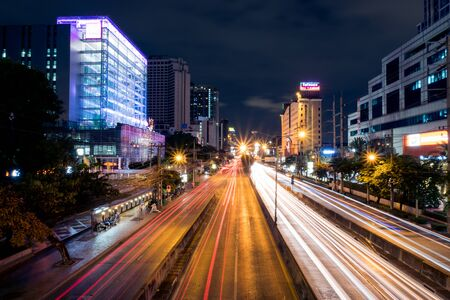 Bangkok, Thailand - July 13, 2018 : Traffic light trails at Night in Ratchadapisek road, captured with long exposure