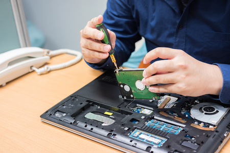 Technician support upgrade part and fixing laptop. select focus, Computer repair concept.