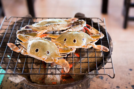Crab on charcoal grill seafood Фото со стока