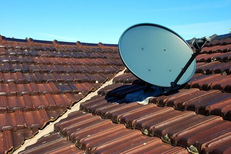 A Satellite Dish on a house roof Stock Photo - 3737003