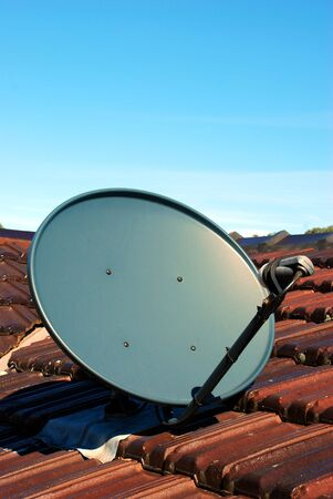 A Satellite Dish on a roof portrait style Stock Photo - 3736998