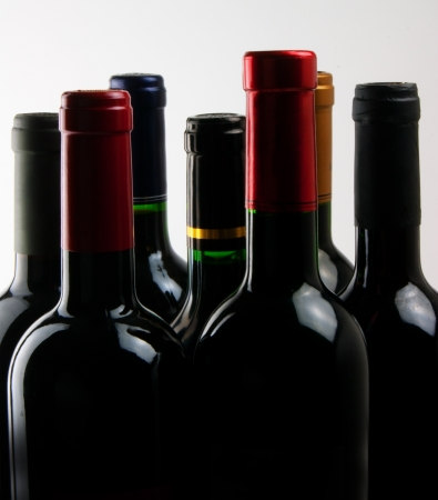A background of wine bottles.  Stock Photo