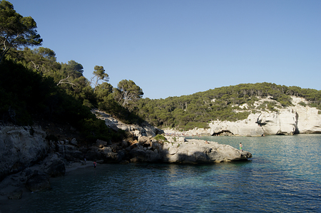 Typical coastline of Menorca. You can see the Mediterranean sea, vegetation and cliffs.