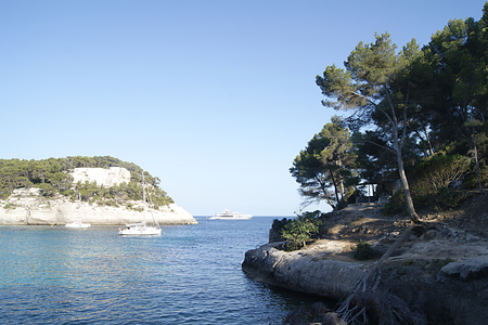 Typical coastline of Menorca. You can see the Mediterranean sea, vegetation and boats