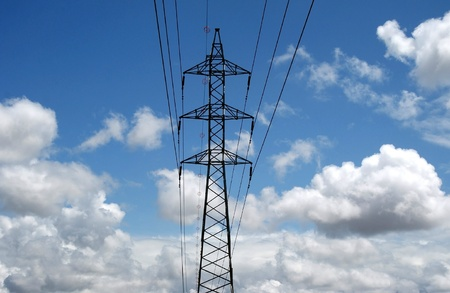 Electricity pylon against blue sky Stock Photo - 13416655