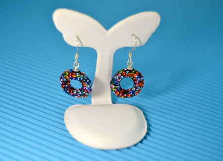 Earrings colored gemstones, close up photo