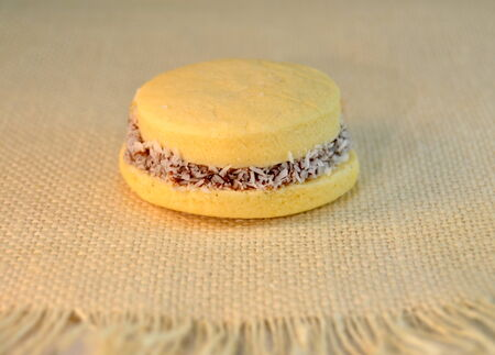 alfajores: Alfajores  cookies with dulce de leche on a table, closeup Stock Photo