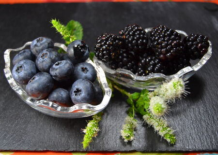 Blueberries and blackberries on dark background photo