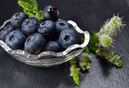 Blackberries on dark background, closeup photo