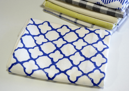 dishtowel: Pile Of Dish Towels on a white table