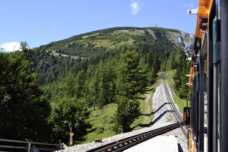 schneeberg: Railway and tourist train in Schneeberg in Austria in summer Stock Photo