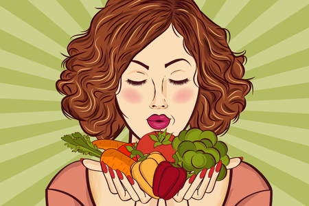 beautiful red-haired lady with vegetables in his hands