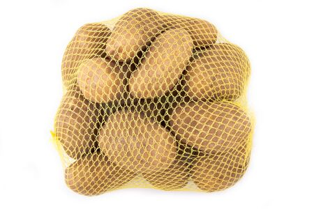 russet: A yellow mesh bag of russet potatoes. Stock Photo