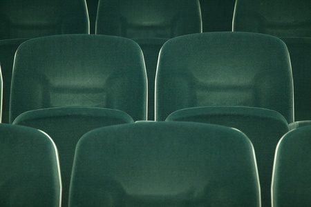 Empty green seats for cinema, theater, conference or concert photo