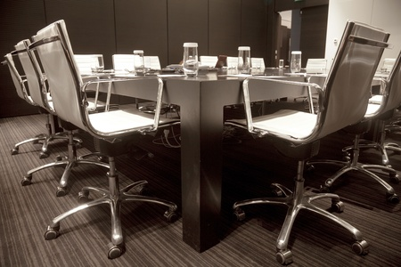Meeting room interior with table, raw of chairs and block-notes,decorated in black and white tones Stock Photo - 11056280