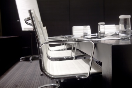 Meeting room interior with table, raw of chairs and block-notes,decorated in black and white tones Stock Photo - 11056274