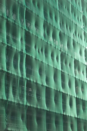 Front of Building, covered with green net ready for renovation. photo