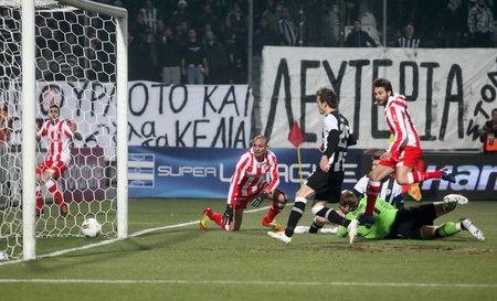 THESSALONIKI, GREECE - FEBRUARY 5: The first goal of Olympiakos with Djamel Abdoun(R) in football match between Paok and Olympiakos (0-2) on February 5, 2012 in Thessaloniki, Greece