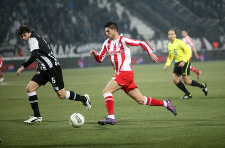 THESSALONIKI, GREECE - FEBRUARY 5: Kevin Mirallas(C), Thanasis Giahos (R), Pablo Gabriel Garcia Perez (L) in football match between Paok and Olympiakos (0-2) on February 5, 2012 in Thessaloniki, Greece