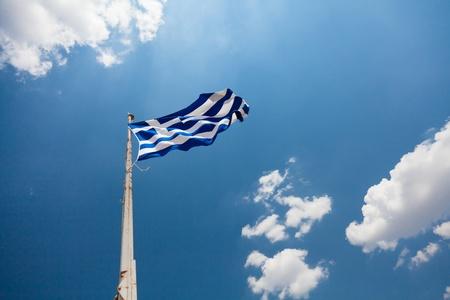 National flag of Greece waving over blue sky photo