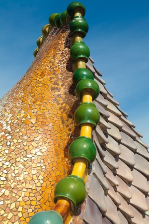 Roof architecture at Casa Batllo. Building restored by Antoni Gaudi and Josep Maria Jujol. Complex chimney detailing of the roof is arched and was likened to the back of a dragon or dinosaur.