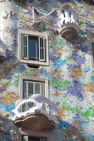 BARCELONA - APRIL 14: The facade of the house Casa Battlo (also could the house of bones) designed by Antoni Gaudi with his famous expressionistic style on April 14, 2012 in Barcelona, Spain