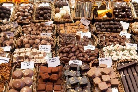 BARCELONA, SPAIN - APRIL 14: Famous La Boqueria market with nuts, chocolate delicacies, fruit jellies and dry fruits on April 14, 2012 in Barcelona, Spain. One of the oldest markets in Europe that still exist. Established 1217.