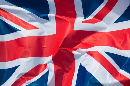 Detail of silky national flag of Great Britain flag drapery