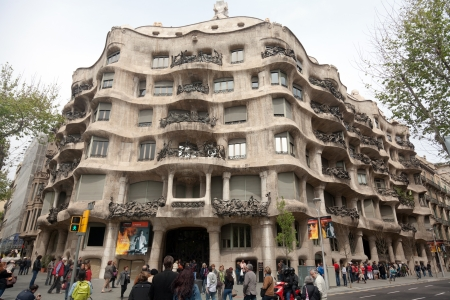 BARCELONA, SPAIN - APRIL 14: Casa Mila or La Pedrera on April 14, 2012 in Barcelona, Spain. This famous building was designed by Antoni Gaudi and is one of the most visited of the city. Editorial