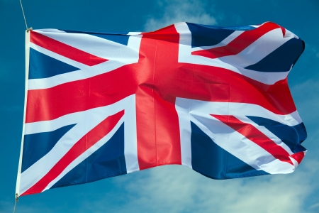 Great Britain flag against blue sky photo