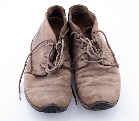 Pair of old leather boots isolated on the white background Stock Photo